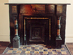 ONE OF THE FIVE FIREPLACES
