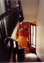 THE MAIN STAIRCASE AND FRONT DOOR